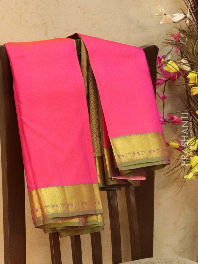 Pure kanjivaram silk sareee dual shade of pink and green with plain body and zari woven temple border