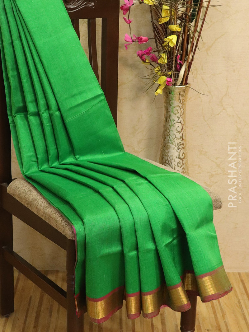 Silk cotton sarees green and pink with simple zari woven border