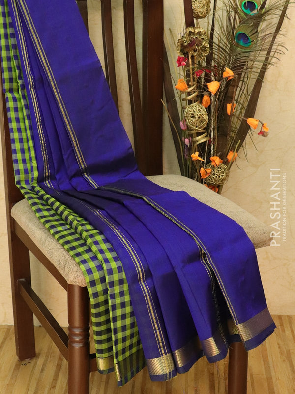 Silk cotton sarees green and blue checked pattern and simple zari border