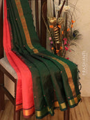 Silk Cotton saree brick orange and bottle green with hand embroidery and golden zari border