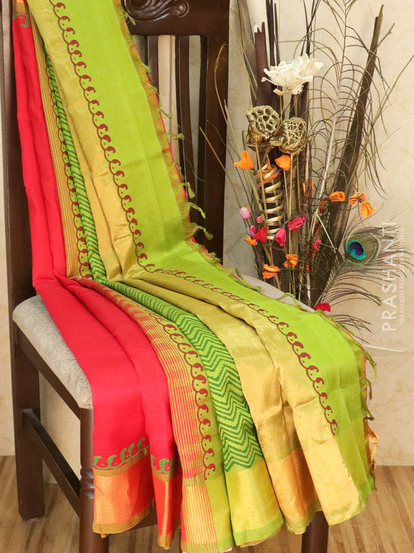 Block printed silk cotton partly saree red and green with paisley buttas and golden zari border