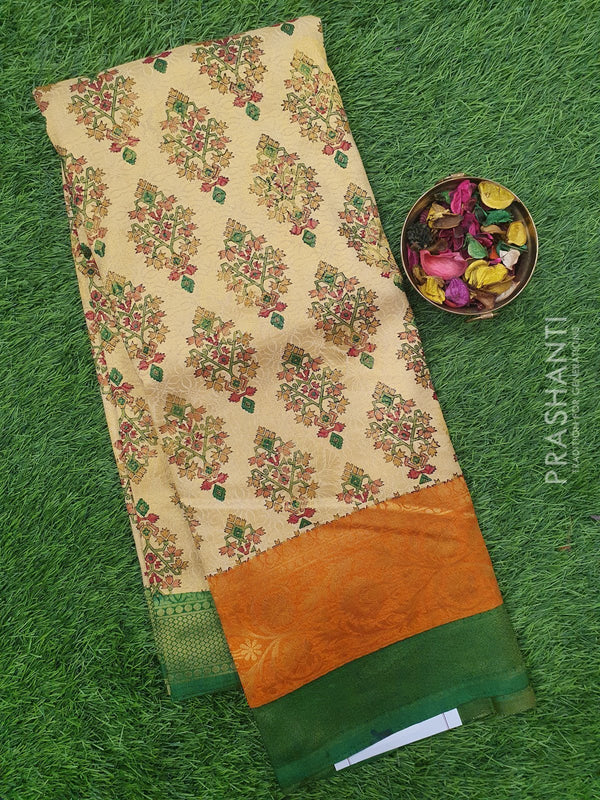 Semi silk saree beige and green with rich zari weaving and all over prints