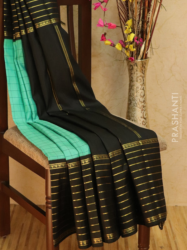 Pure Kanjivaram Silk saree teal and black with rettapet border and traditional korvai weaving