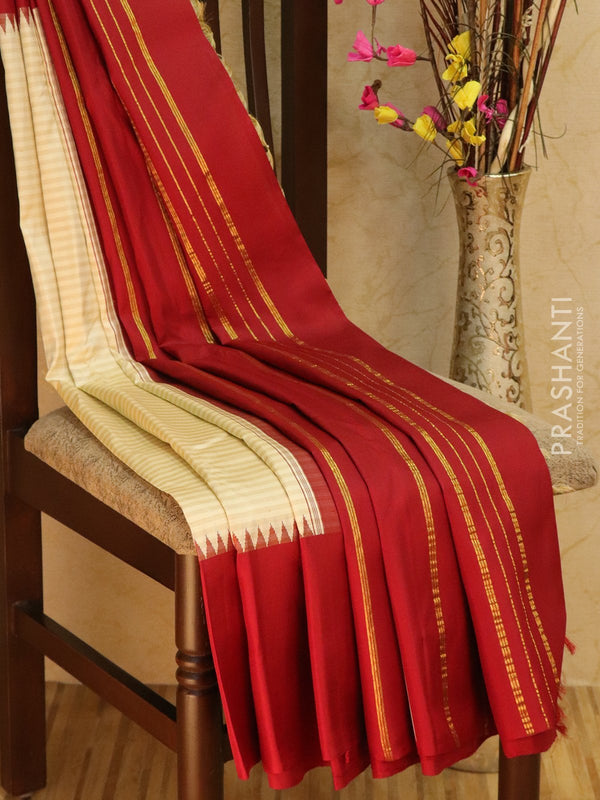 Pure Kanjivaram Silk saree off white and maroon with temple thread border in korvai weaving