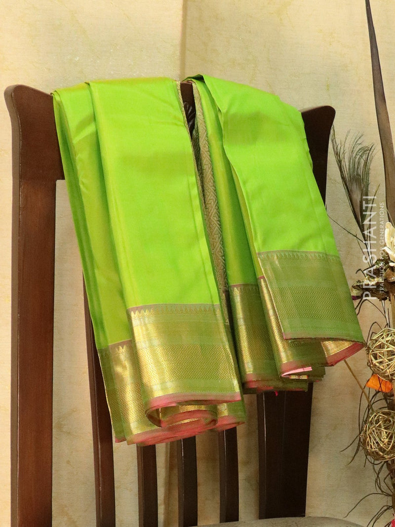 Pure Kanjivaram silk saree green and dual shade of purple with plain body and rich zari woven border