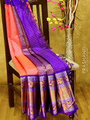 Kuppadam silk cotton saree tomato pink and violet with zari checks and long zari floral border