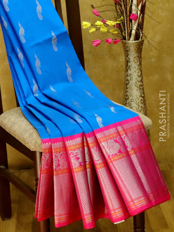 Kuppadam silk cotton saree blue and pink with silver zari buttas and long annam border