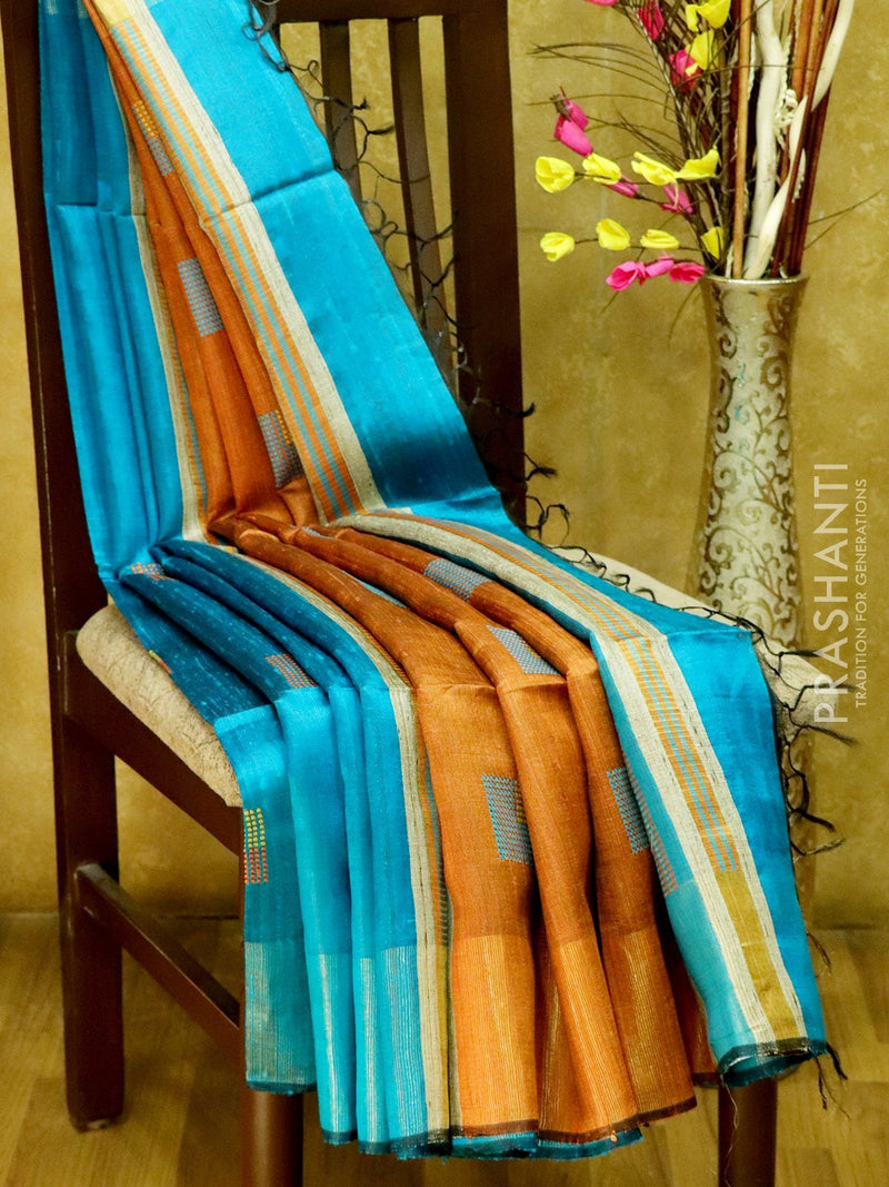 Dupion Silk saree blue and rust with geometric thread weavings and golden zari border