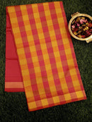 Semi Silk Cotton saree golden yellow and pink with checked pattern and zari border