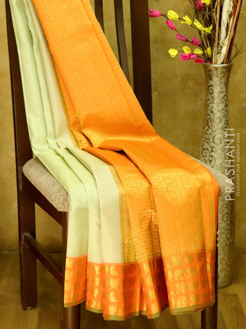 Pure Kanjivaram Silk Saree beige and peachish pink with annam elephant coin and lotus buttas in border