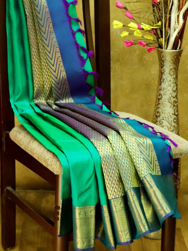 Pure Kanjivaram Silk Saree green and peacock blue with plain body and rich zari border