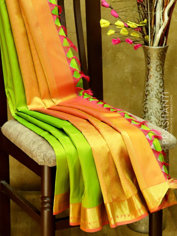 Pure Kanjivaram Silk Saree lime green and peach with plain body and rich zari border