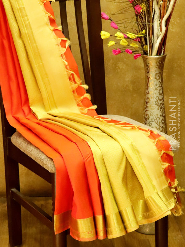 Pure Kanjivaram Silk Saree orange  with plain body and rich zari border