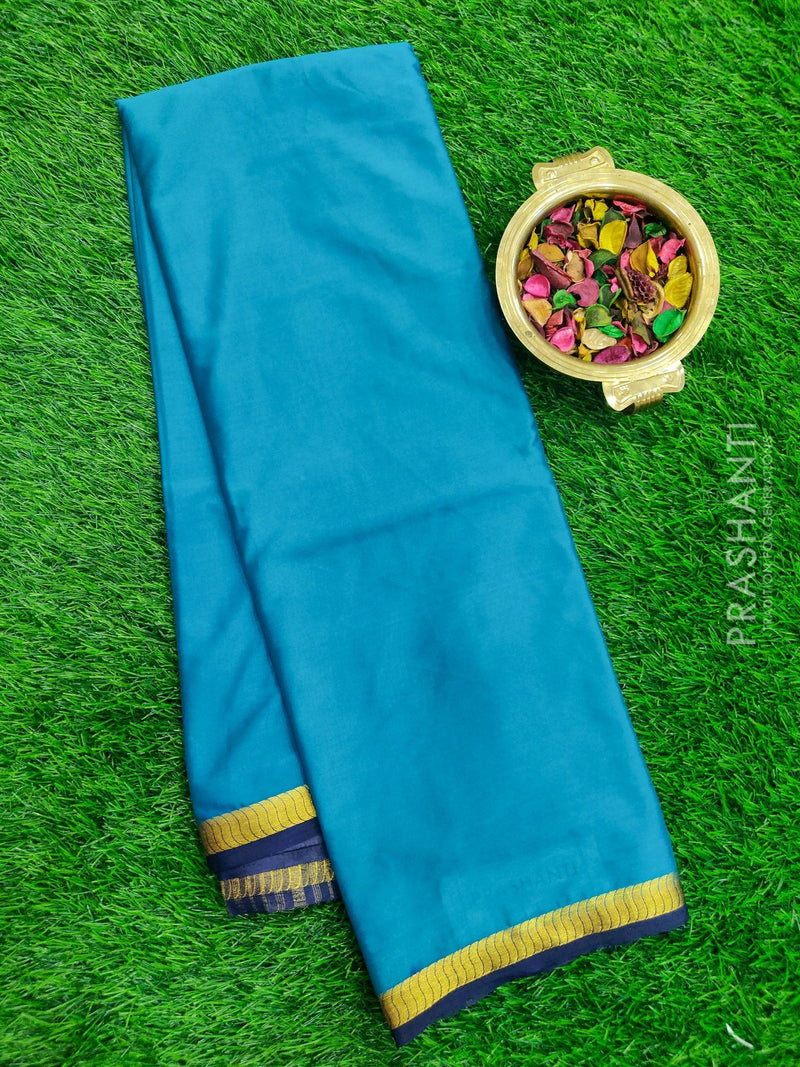 Semi Crepe saree green and navy blue with plain body and golden zari border