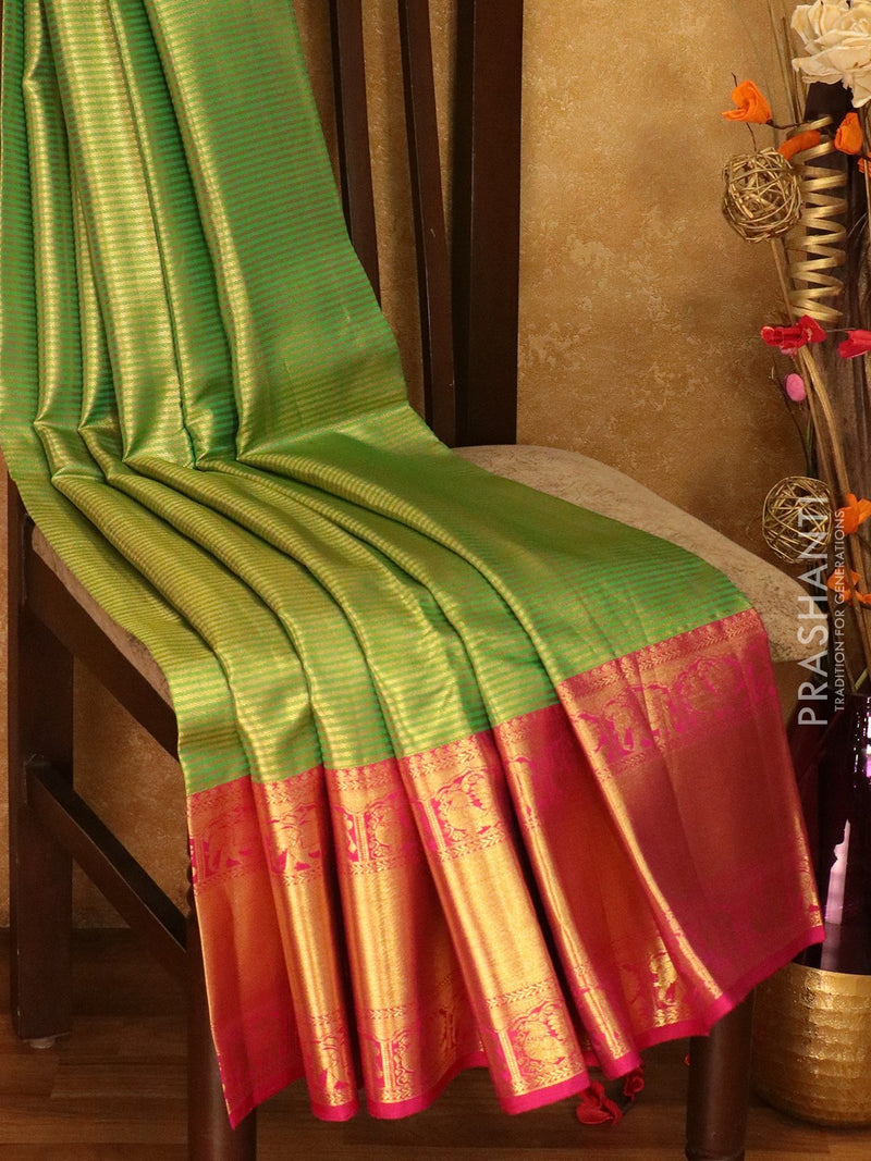 Pure Kanjivaram silk saree green and magenta horizatal zari live weaving with rich traditional zari border