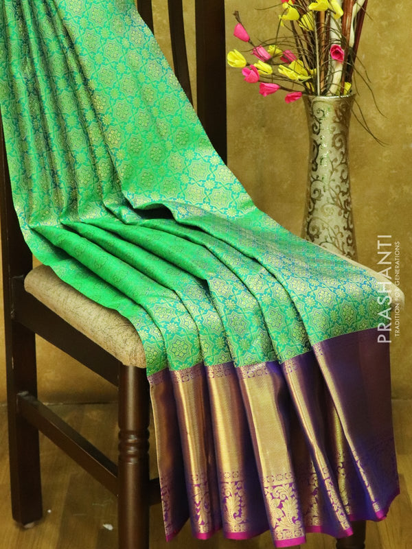Pure Kanjivaram silk saree dual shade of green and purple all over zari brocade with rich traditional zari border