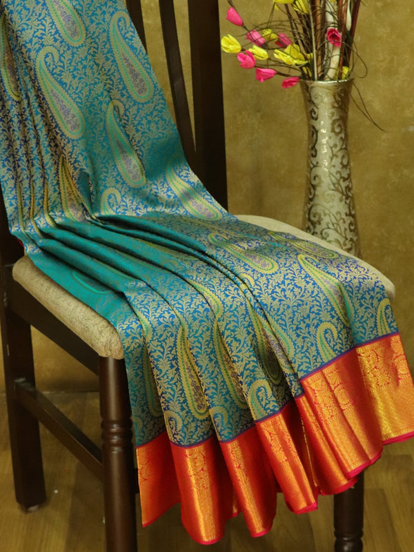 Pure Kanjivaram silk saree peacock blue and pink all over floral and paisley weaving korvai border with rich traditional zari border