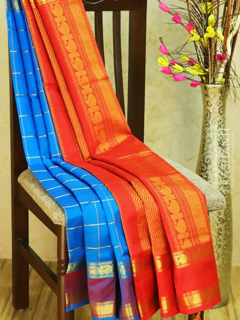 Silk cotton Partly saree cs blue and red with zari checks and rettapet border