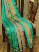 Dupion silk saree teal and mild grey with geometric thread weaving and golden zari border