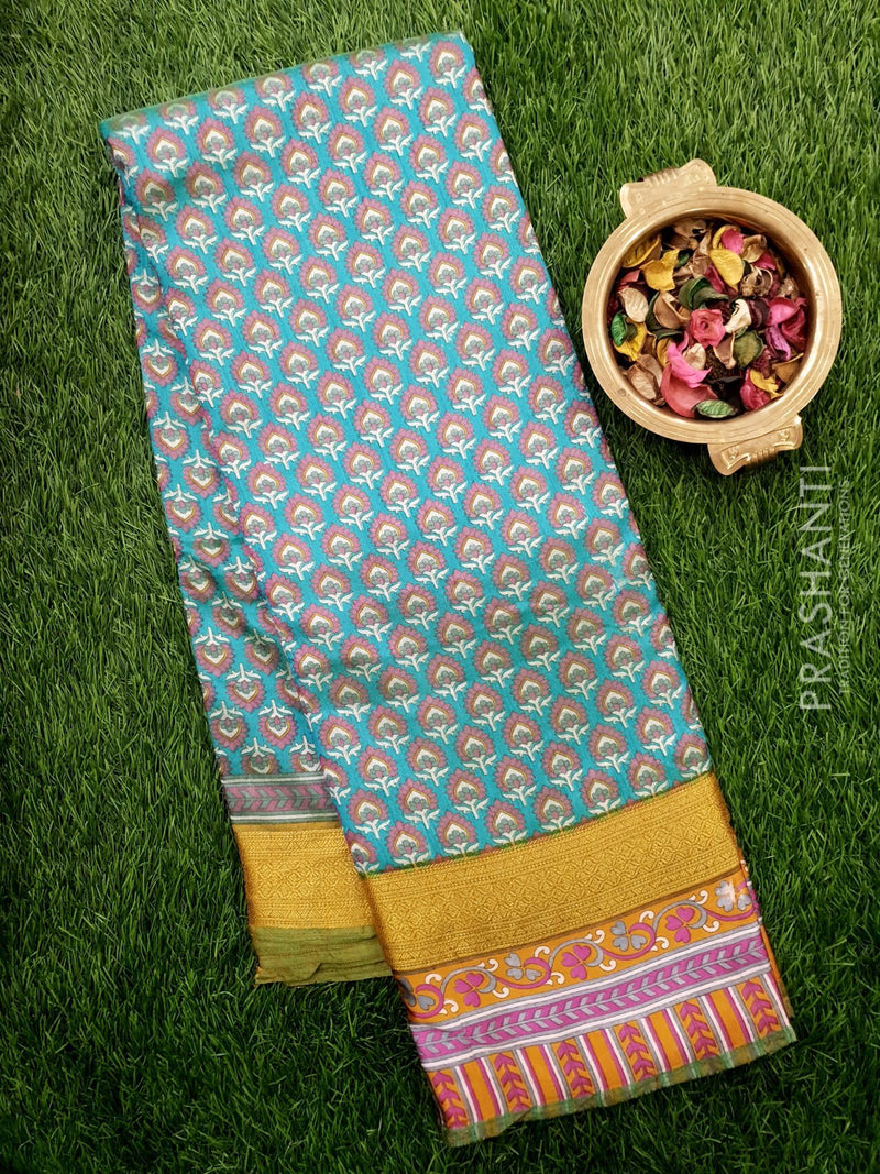 Semi Raw silk saree dual shade of blue and green with allover floral prints and golden zari printed border