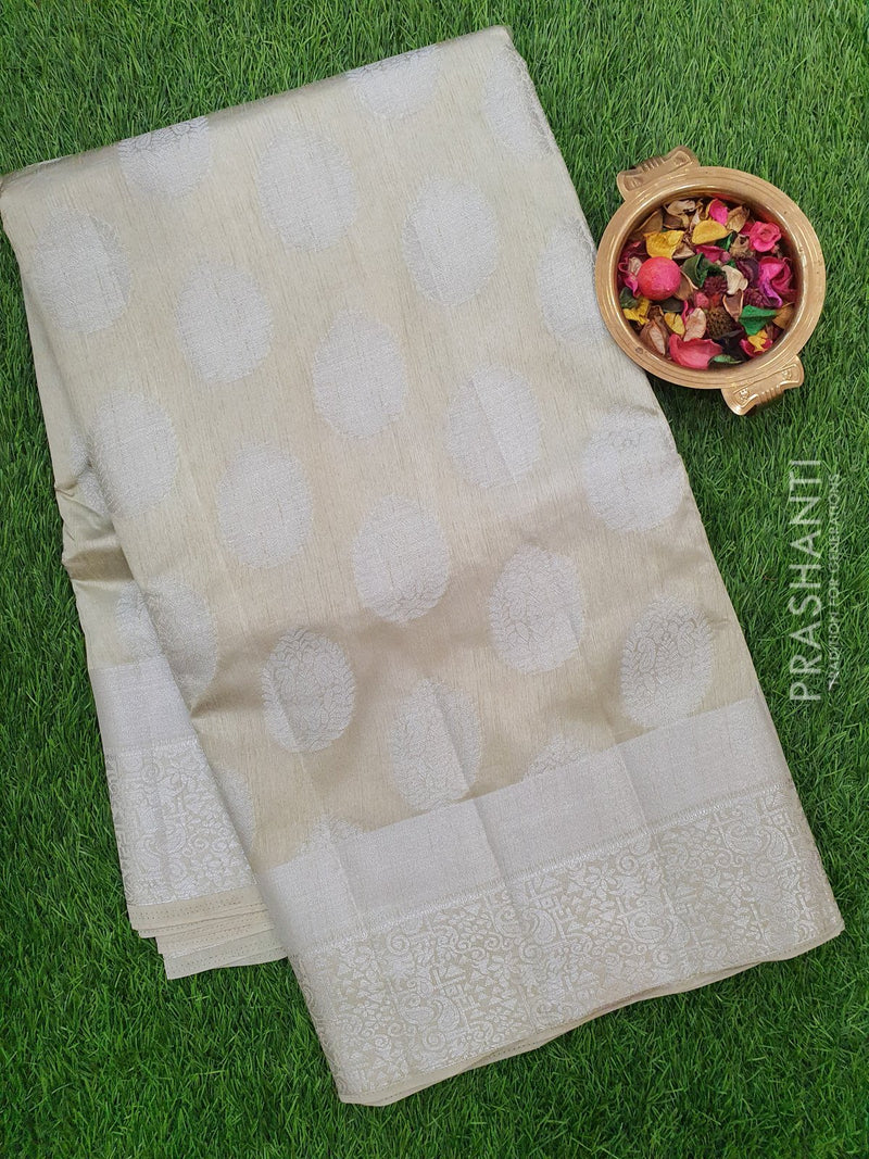 Semi Raw silk saree cement grey with silver zari border and all over buttas