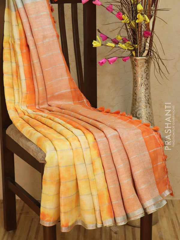 Pure Linen Saree pale yellow and orange checked pattern with tie and die prints and silver zari border