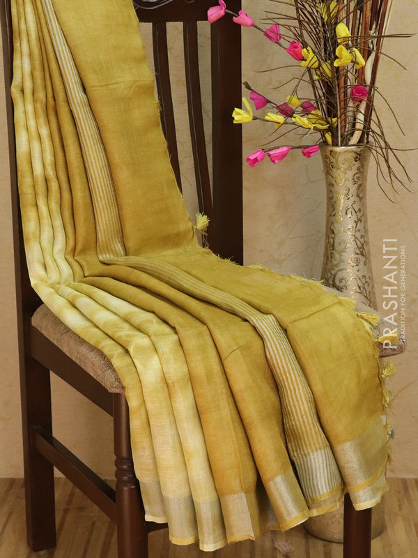 Pure Linen Saree pale yellow and mustard with tie and die prints and silver zari border