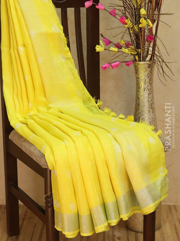 Pure Linen Saree yellow with tie and die prints and silver zari border