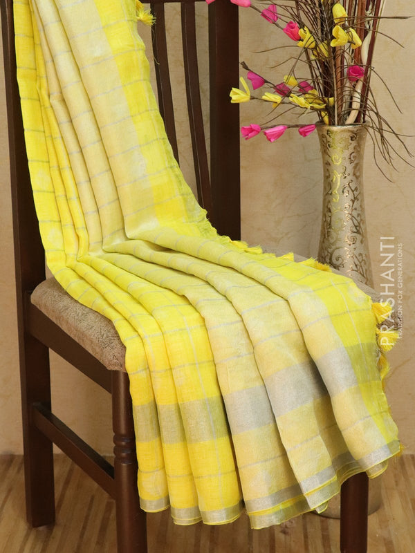 Pure Linen Saree yellow checked pattern with tie and die prints and silver zari border