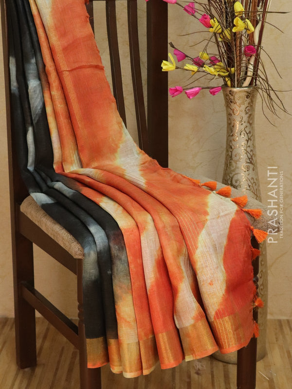 Pure Linen Saree black and peach orange with tie and die prints and golden zari border