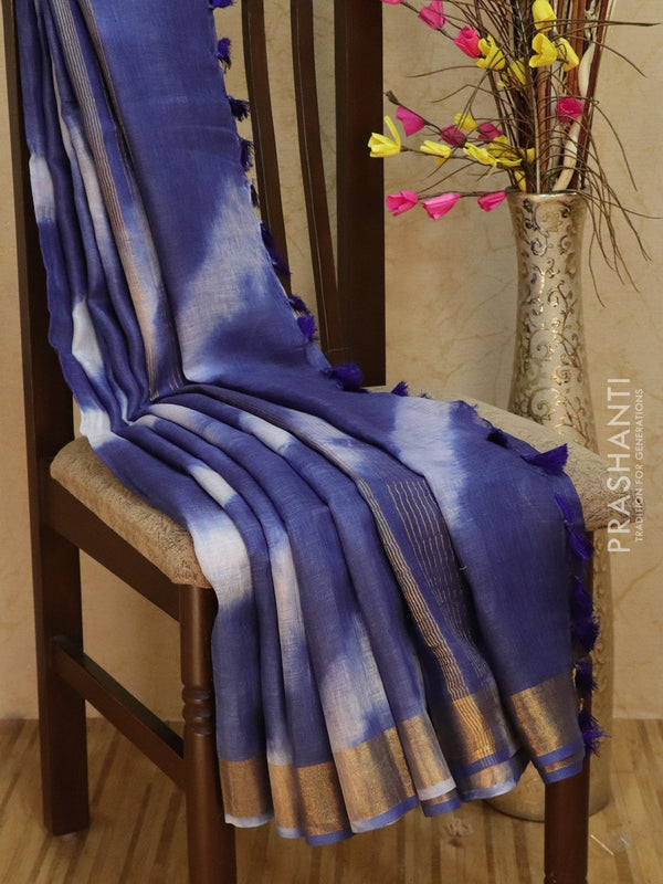 Pure Linen Saree off white and blue with tie and die prints and golden zari border