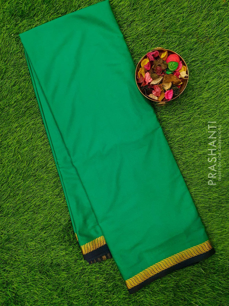 Semi Crepe saree green and navy blue with plain body and rich zari border
