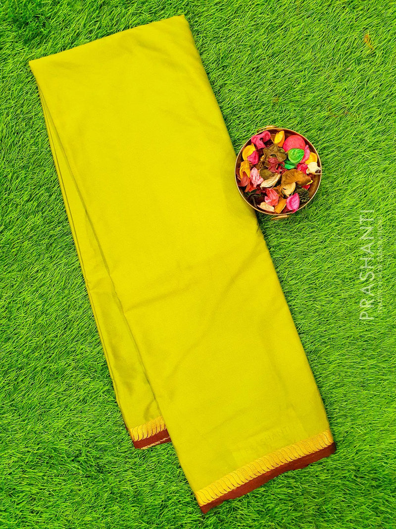 Semi Crepe saree green and coffee brown with plain body and rich zari border
