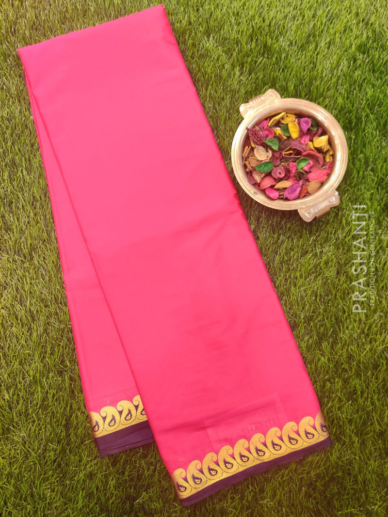 Semi Crepe saree pink and navy blue with plain body and paisley zari border