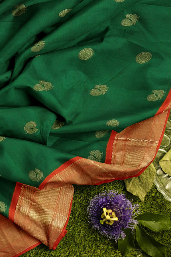 Pure Kanjivaram silk saree green and orange with golden zari border and buttas