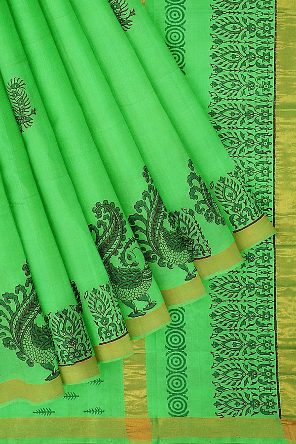 Hand block printed silk cotton saree grass green with beautiful peacock design and zari border
