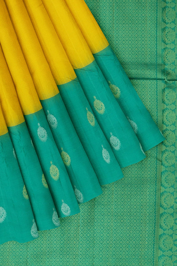 Kanjivaram silk saree yellow and teal green with golden and silver zari jumuka buttas korvai border