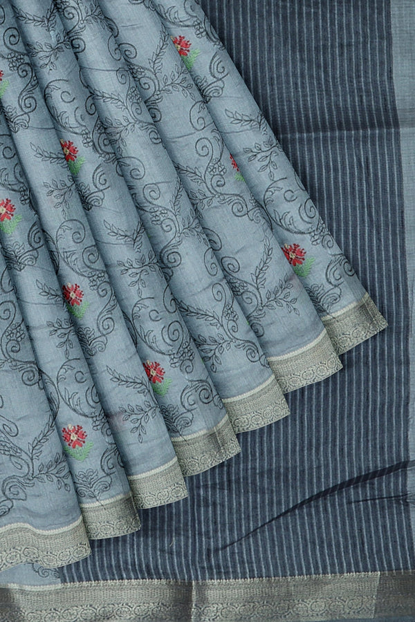 Semi Tussar saree stone blue with overall floral embroidery and simple zari border