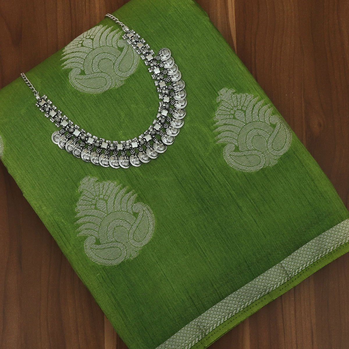 Raw Silk Saree Green with Simple border and jewel