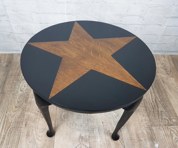 Black star design upcycled table with exposed Tiger Oak grain