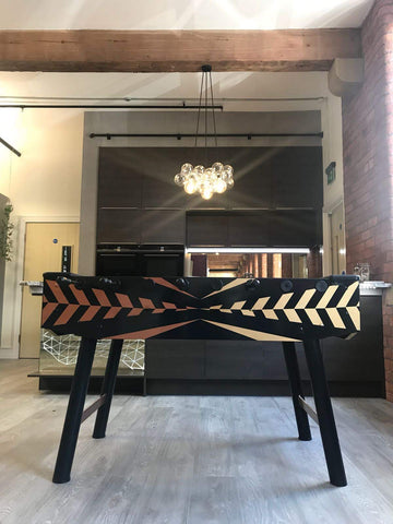 Black, gold and copper design fussball table