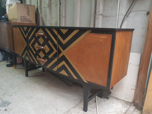 Black and gold commission sideboard