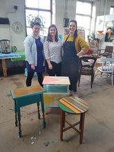 3 workshop participants with their completed up cycled furniture at workshop in leeds