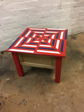 side table upcycled with red blue and white geometric masking project