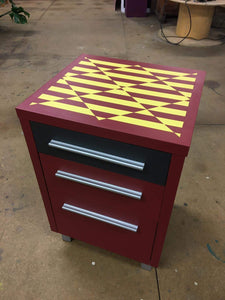 set of drawers upcycled with red and yellow vibrant modern geometric design
