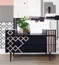 Geometric sideboard designed with pink and black against geometric backdrop