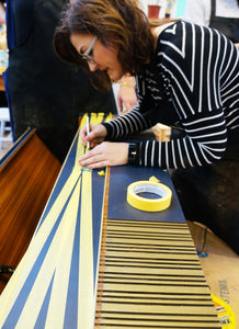 nicky owner of done up north in action with masking tape preparation for upcycling project