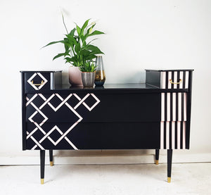 Art Deco geometric designed sideboard with pink and black in situ