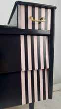 Geometric pink and black drawers close up