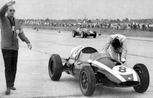 Jack Brabham pushing home his Cooper to the World Championship